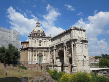 Arch of Septimius Severus , with Santi Lucia e Martina church designed by Pietro da Cortona behind it.