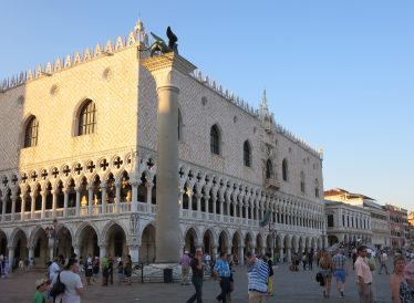 Venice: The Doge's Palace. The Duchess dove at the Duke just when the Duke dove at the Doge. Now the Duke ducked, the Doge dodged, and the Duchess didn't. So the Duke got the Duchess, the Duchess got the Doge, and the Doge got the Duke.